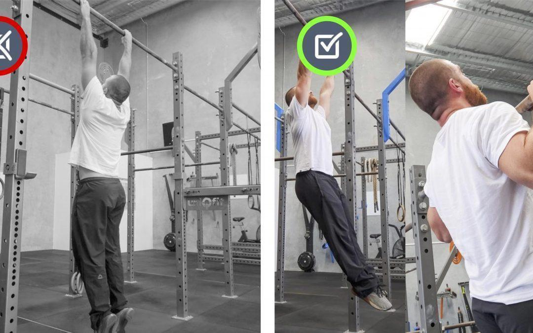 Lower back extended. Pull-up/Hang Movement Therapy.